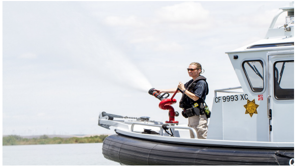 Photo of Marine Patrol Boat and Officer